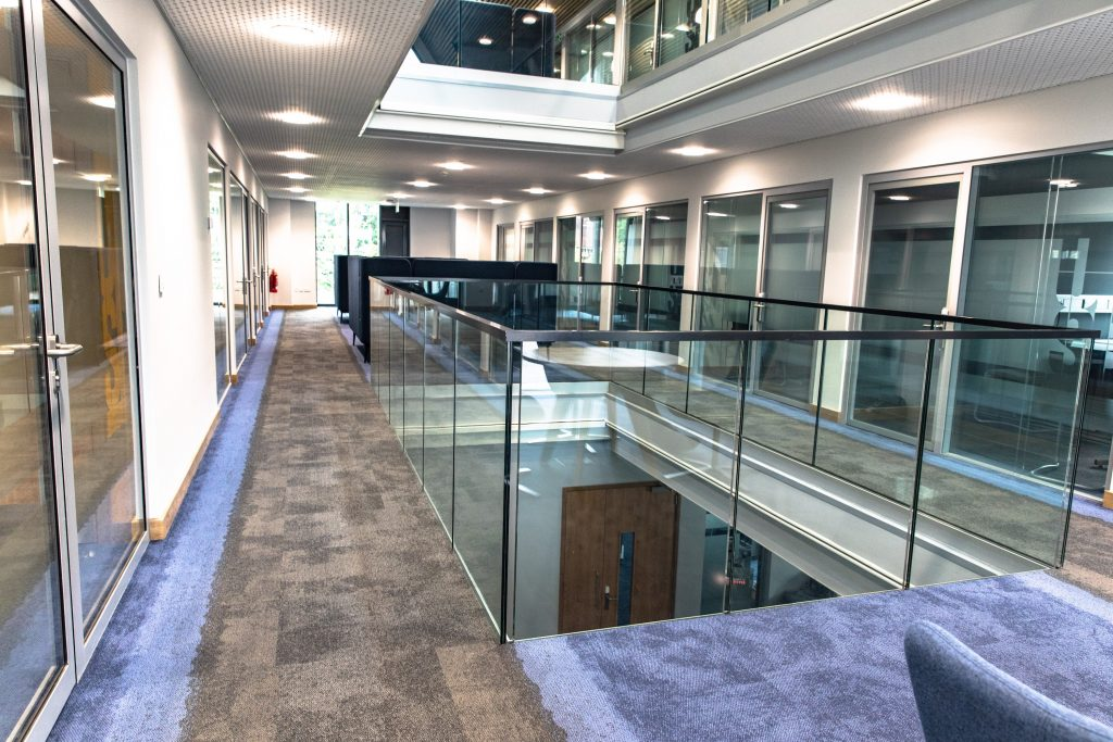 The internal frameless glass balustrade in the Business School at the University of Leicester