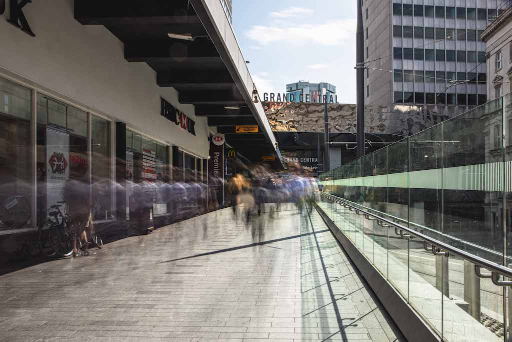 An image of Birmingham New Street Station looking towards the Grand Central hotel, Birmingham, UK.