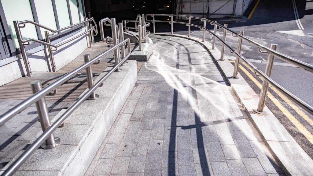 The walkway complete with Glass & Stainless powder-coated railings either side.